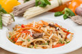 Noodles with vegetables and garnish on white plate hot Royalty Free Stock Photos