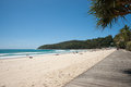 Noosa queensland australia boardwalk and beach at people sunbathing and enjoying a summer day at beach in march Stock Photos