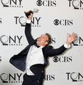 Norbert Leo Butz:  Jumping for Joy Stock Photo