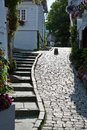 Nordic cobbles a cobbled street with typical wooden houses Royalty Free Stock Image