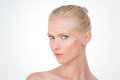 Nordic girl testing salve on white background blond woman with cream her front and her cheekbone Stock Photo