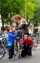 Nordic Lifestyle - Young Mum with Her Two Kids at a Supermarket Bike Park, Amsterdam Royalty Free Stock Photo