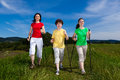 Nordic walkers walking active family outdoor Royalty Free Stock Photos