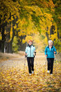 Nordic walking mother and daughter train Stock Photo