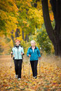 Nordic walking mother and daughter train Stock Image