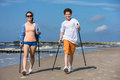 Nordic walking young people working out on beach teenage girl and boy Stock Images
