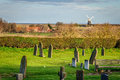 Norfolk windmill a by the uk coast as seen from church graveyard Royalty Free Stock Photos