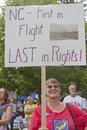 North carolina rights protester asheville usa august a woman holds a sign protesting s lack of on august at a moral monday Royalty Free Stock Photography