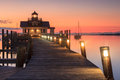 North carolina roanoke marsh lighthouse the illuminated boardwalk and screwpile at sunrise in manteo Stock Photos