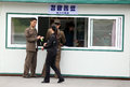 North korea korean soldiers buy a cold drink in the street kiosks Royalty Free Stock Image