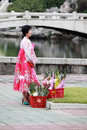 North korea koreas flower girl standing on the street in pyongyang here is pyongyang mansudae park she sold flowers to foreign Stock Images