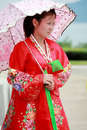 North korean female a narrator holding an umbrella in nampo tourist area she is waiting for visitors Royalty Free Stock Photography