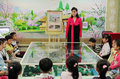North korean kindergarten here is a model it is located in korea sinuiju the teacher is telling kim il sung the Stock Images