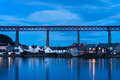 North queensferry town of at blue hour after sunset forth rail bridge connecting edinburgh to fife on background Royalty Free Stock Photos