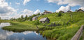 North Russian village. Summer day, river, old cottages on coast. Royalty Free Stock Photo
