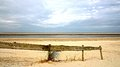 North sea beach with wooden fencing on of island of ameland in the netherlands Stock Photos