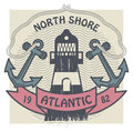 North shore atlantic label grunge stamp or with lighthouse and the words written inside Stock Photo