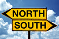 North or south opposite signs two against blue sky background Royalty Free Stock Photos
