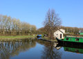 Northern end of navigable part of lancaster canal two narrow boats at the the the at tewitfield lancashire england Royalty Free Stock Photo
