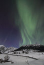 Northern light above the hills of offersoey lofoten islands Royalty Free Stock Images
