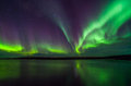 Northern lights above calm sea Stock Photography