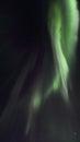Northern lights above gimsoeystraumen light mirroring in the fjord facing gimsoey lofoten islands Royalty Free Stock Image
