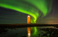 Northern lights above lighthouse image of the the hã lmsbergsviti at reykjanes peninsula in iceland Royalty Free Stock Photo