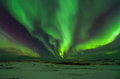 Northern lights above snowy land Royalty Free Stock Images