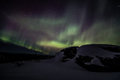 Northern lights aurora borealis in alaska seen from the rocky peak of mount near fairbanks Royalty Free Stock Photos