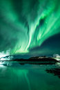 Northern lights aurora borealis dancing sky its reflection dancing surface blue lagoon iceland Stock Image
