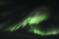 Northern lights curtains over gimsoey light mirroring in the fjord facing lofoten islands Royalty Free Stock Photography