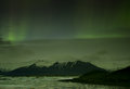 Northern lights in jokulsarlon iceland site for floating ice bergs Royalty Free Stock Photo