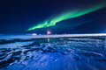 The Northern lights in the mountains of Svalbard, Longyearbyen, Spitsbergen, Norway wallpaper Royalty Free Stock Photo