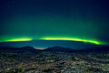 Northern lights over distant mountains Royalty Free Stock Photo