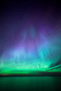 Northern lights over lake in finland Royalty Free Stock Photo