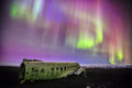 Northern lights over plane wreck  in Vik, Iceland Royalty Free Stock Photo