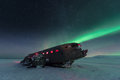 Northern lights over plane wreck on the wreck beach in Vik, Iceland