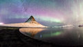 The Northern Lights and winter milky way over Kirkjufell Royalty Free Stock Photo