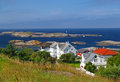 Norway coast with houses and rocky island Stock Image