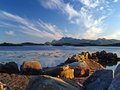 Norway coast at sunset fjord with mountain Royalty Free Stock Photo