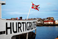 Norwegian coastal express hurtigruten is a daily passenger and freight shipping service along norway s western and Stock Photo