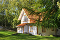 Norwegian country house orange white family with green yard Royalty Free Stock Images