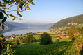 Norwegian countryside fjords and houses in the Stock Photography