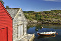 Norwegian fishing huts and lake scenic view of colorful rowing boat on in norway Stock Photos