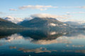 Norwegian fjord and mountains with clouds reflection Stock Image