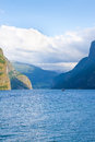 Norwegian fjord with a ship on the horizon Stock Photos