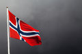 Norwegian flag blowing in the wind on a dark background Stock Photo