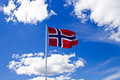 Norwegian flag on blue sky and clouds Stock Photography
