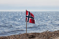 Norwegian flag norway at coast Stock Image
