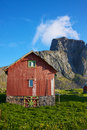 Norwegian shed traditional under the cliffs on island of vaeroy lofoten norway Stock Photos